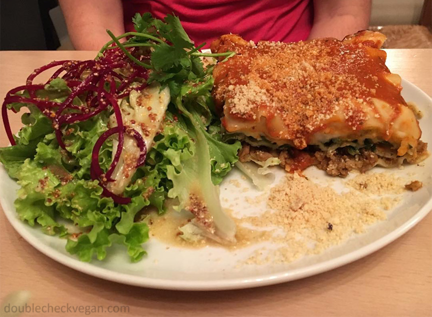 Vegan lasagna with salad at Le Faitout Vegan in Paris.
