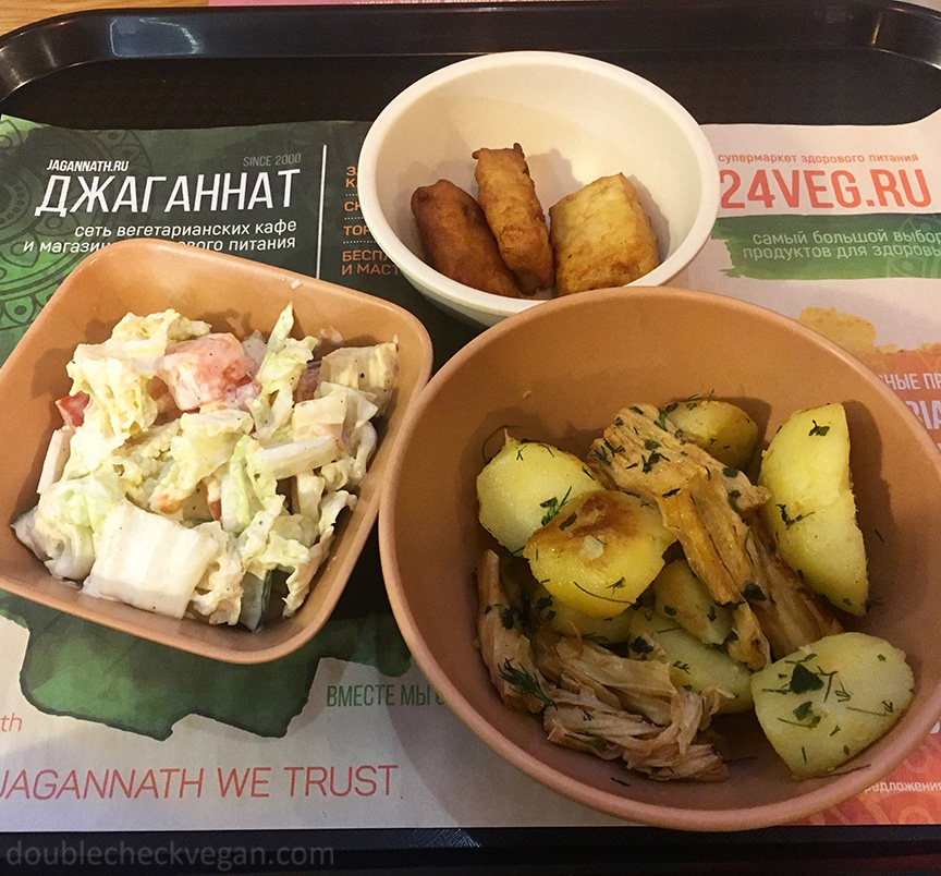 Salad with a creamy vegan dressing, soy nuggets, and potatoes with mushroom at Jagganath vegetarian restaurant in Moscow.